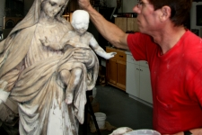 restoration of plaster Madonna